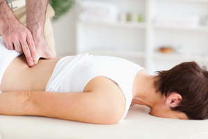 Network Chiropractor Massaging woman